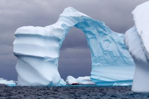 Arch-shaped iceberg in Antarctica
