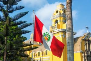 Flag and church in Lima, Peru