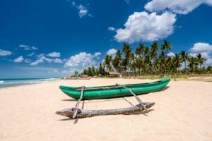 Fishing boat on Nilaveli beach near Trincomalee, Sri Lanka