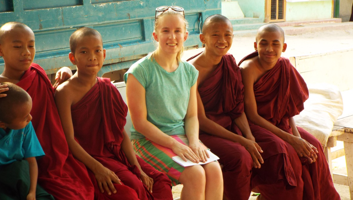 Theresa with young monks in Myanmar