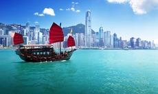 Hong Kong boat and city skyline