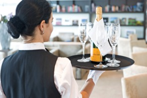 Scenic river cruises - Butler serving Champagne