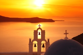 Summer cruises - Sunset over Santorini